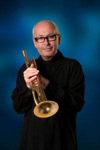 Greg Adams holding trumpet